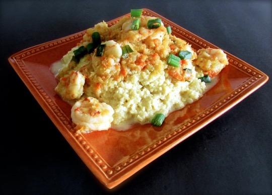 Shrimp Etoufee over cheezy grits 1