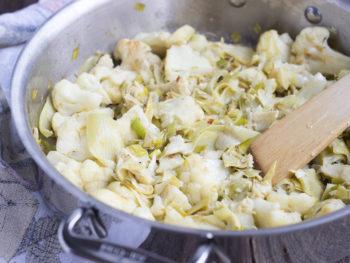 braised cauliflower leeks artichoke hearts in pan