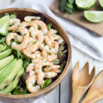 salad bowl with shrimp, lime and avocado