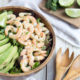 salad bowl with shrimp, lime and avocado