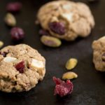 cookies on dark background with pistachios and cranberries