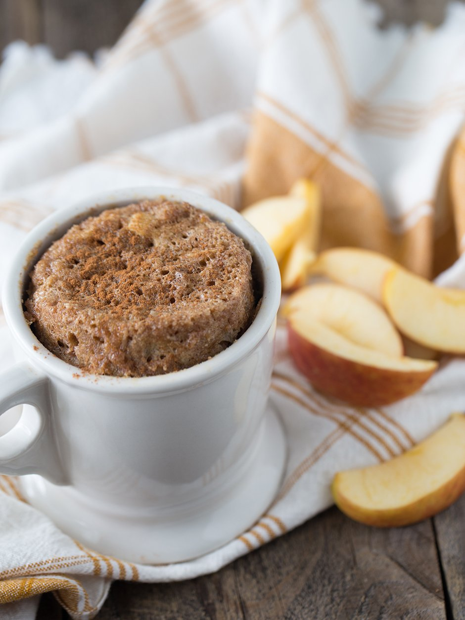 Just one minute and a few healthy ingredients are needed to make this fluffy, light and delicious apple cinnamon muffin recipe! This delicious muffin clocks in at less than calories and is the perfect sweet snack or healthy dessert to have on hand!