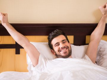 Man waking up happy