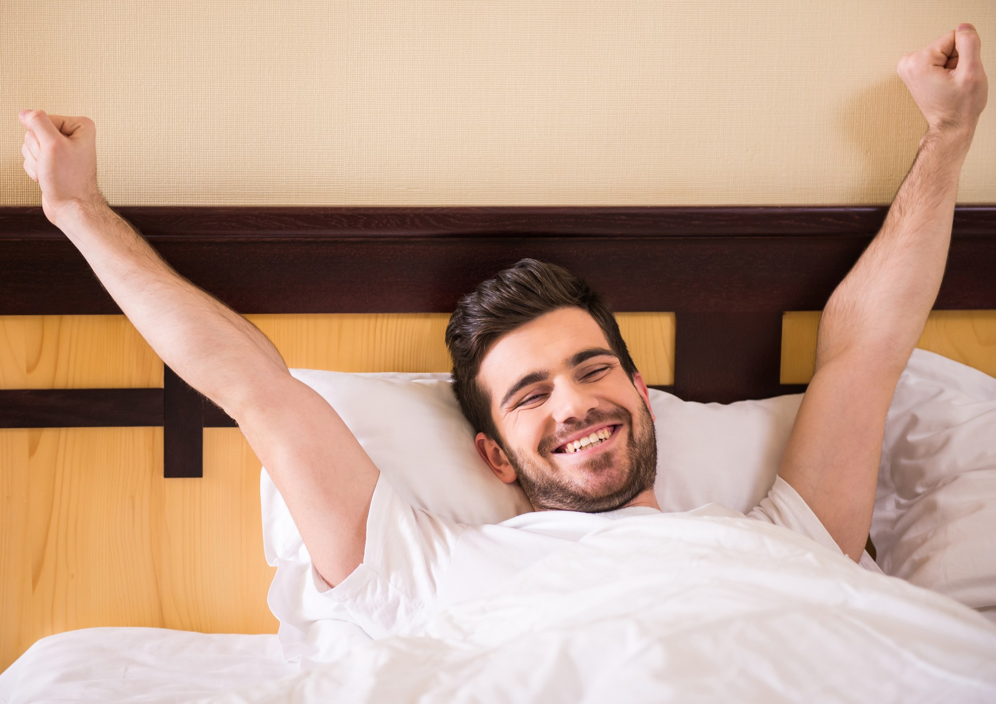Man waking up happy