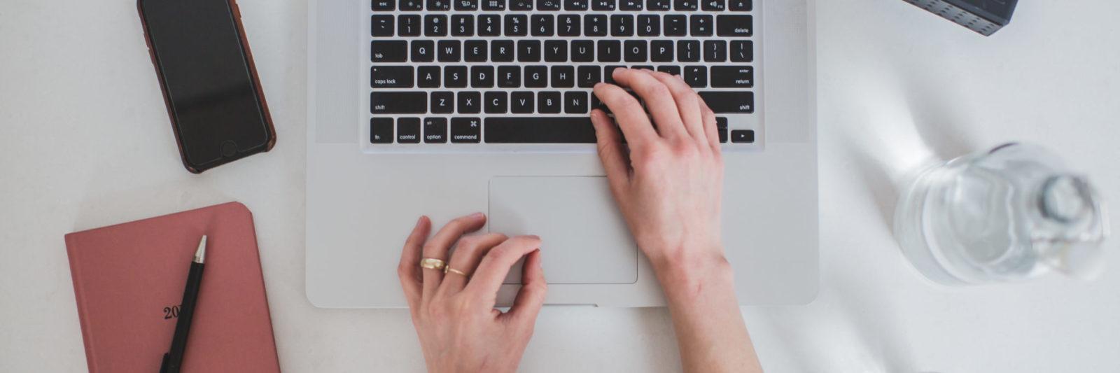 womans hands on a laptop