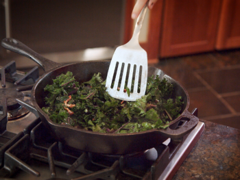 mixing the kale and bacon