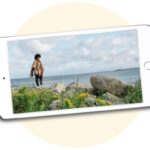 woman at a beach on a phone